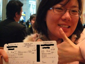 Sonia holding the ticket of AWESOME.